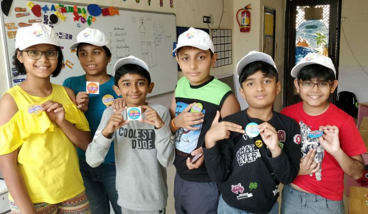 Picture of our participants showing off their badges!